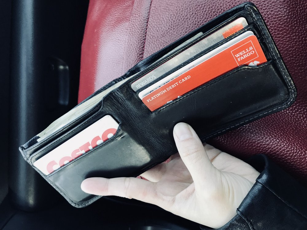 The card insert slots in my boyfriend's current wallet face outwards for easy access. Over time the slots stretched out, so they don't hold the cards as snug as before.