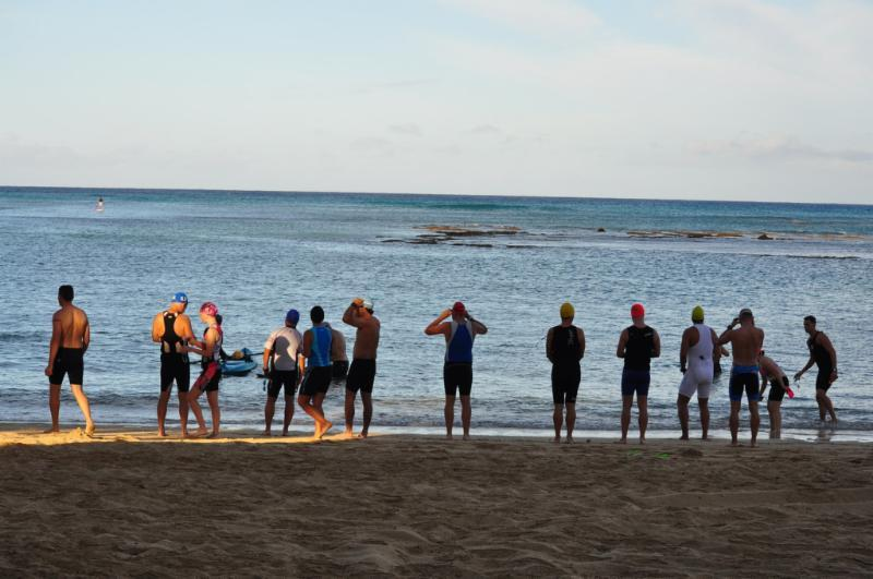 The swim start of the rector's triathlon fundraiser for St. Mark's at Kaimana Beach.
