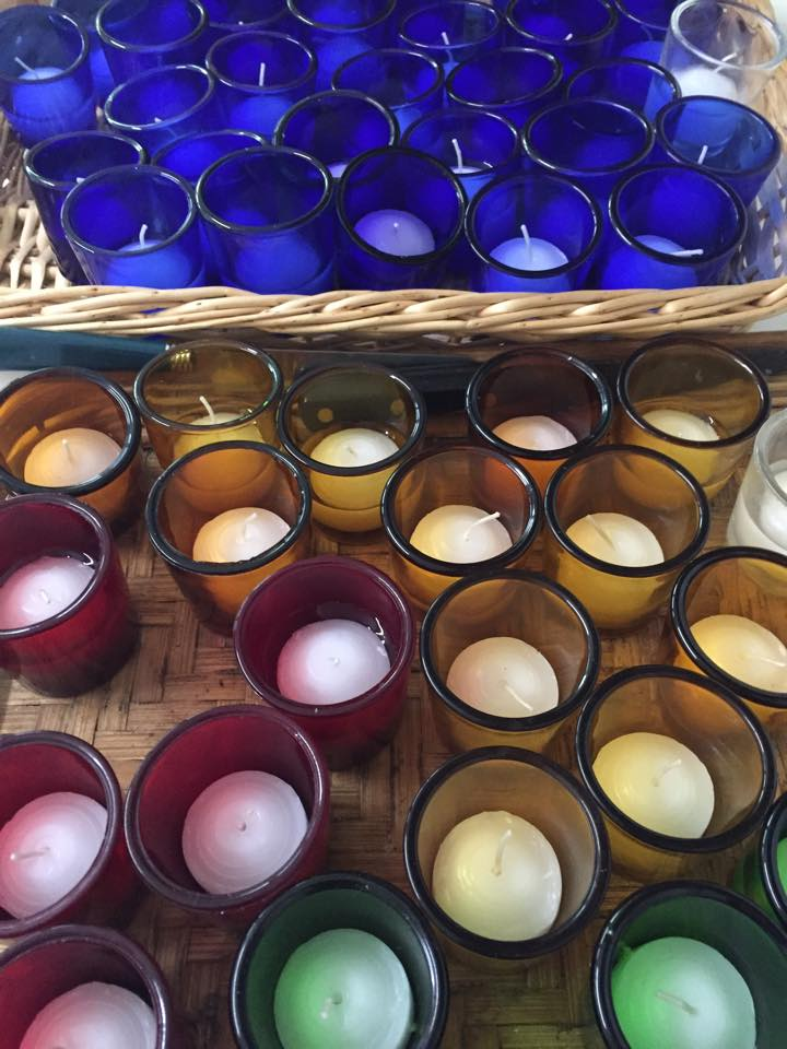 PART OF THE WORK OF PREPARING THE CHURCH FOR WORSHIP AND PRAYER IS THE CONSISTENT REPLACEMENT OF FRESH VOTIVE CANDLES.