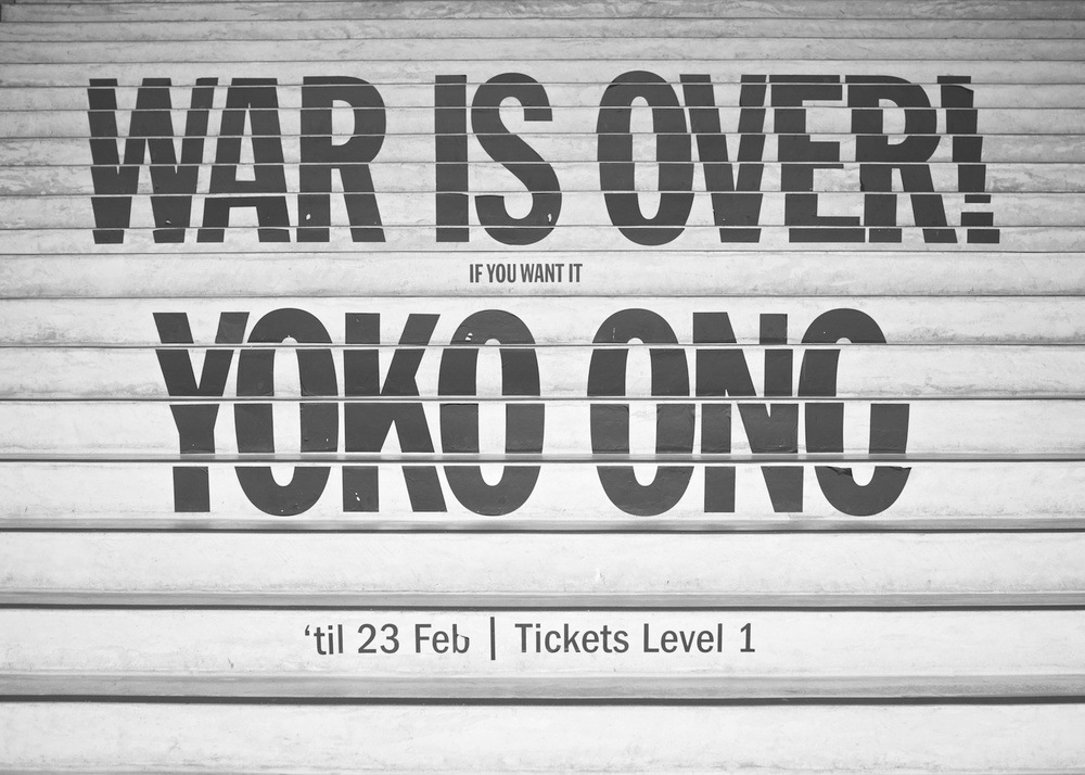 Sign on the staircase of the Museum of Modern Art in Sydney, Australia for the War is over! exhibition by Yoko Ono.