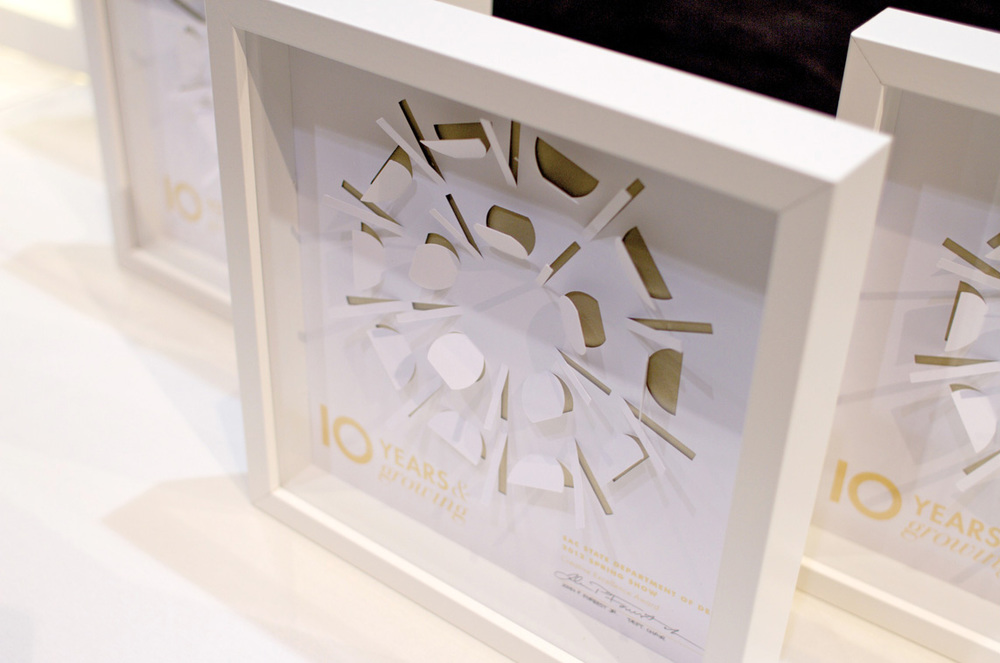 Art Direction: Gwen Amos Die-cut and screenprinted with gold ink.