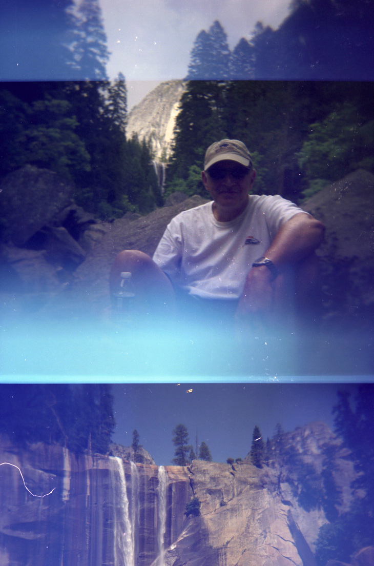 Above: my dad sitting in the spot we stopped to eat lunch. Vernal Falls is in the background framed by the trees.