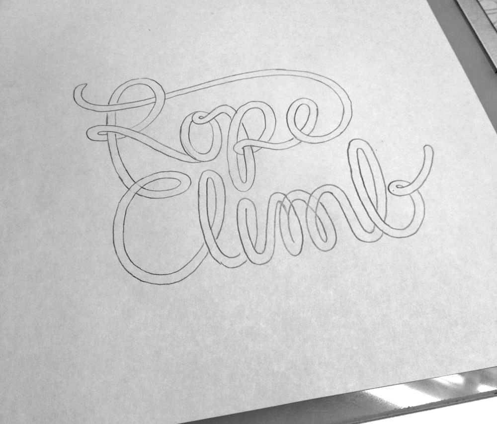 The next step was to refine the sketches. If you look closely, you can see that I increased the space between the two words and cleaned up the curves in the letters.