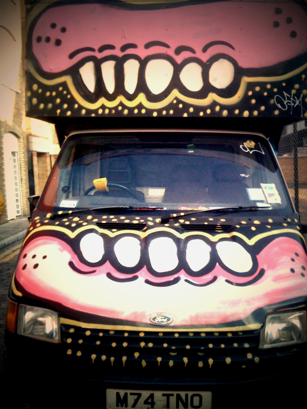 More From Brick Lane, this van is often parked outside my brothers apartment. I think it's a mobile dentist...