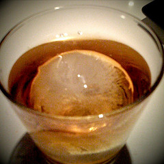 "I have been looking for somewhere to drink my whisky with a nice spherical ice cube. It has nothing to do with the aesthetic and everything to do with physics. A spherical ice ""cube"" has a much improved surface to volume ratio - this reduces the thermal transfer to the ice and makes it last longer. In essence it allows you to sip your whisky at your leisure without getting it all wet and tasteless.  If you are very lucky you can get your whisky or fine bourbon with a spherical ice cube at  50 plates ."