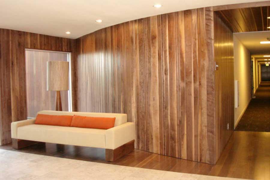 Beam Sofa in Wood Paneled Room