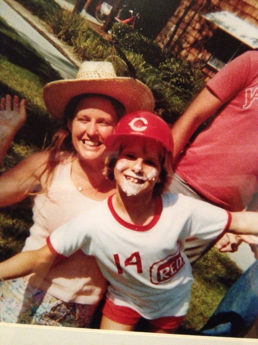 My favorite photo of me and Mom, who threatened a lawsuit to get me on a boys' team. Pity I couldn't hit for beans...