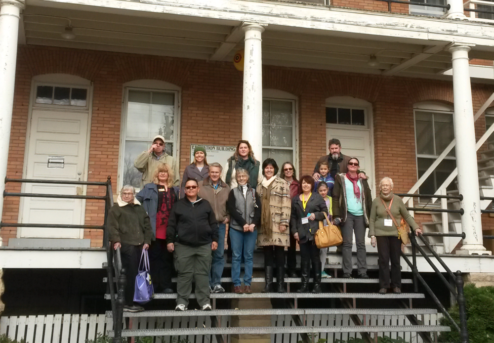 PND tour-goers pose with Dennis Neumann (Back row, left) outside the Education Building at United Tribes Technical College and historic Fort Abraham Lincoln, October 23, 2016.