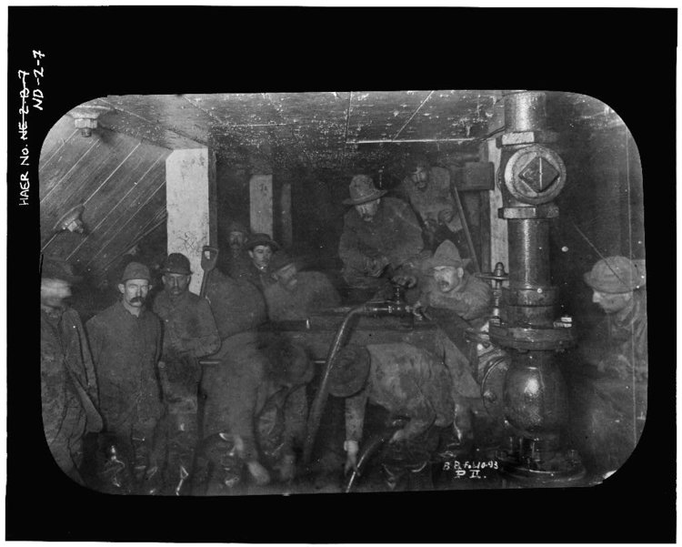Laborers inside caisson during construction, 1880-1883