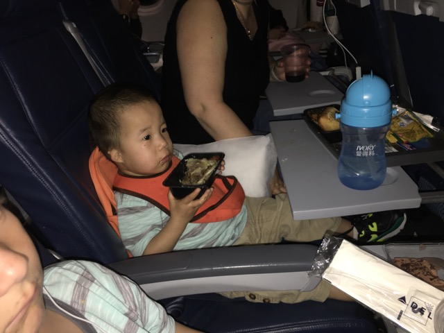 Joshua likes penne so much, he ate it right out of the container. Hooray airplane food.