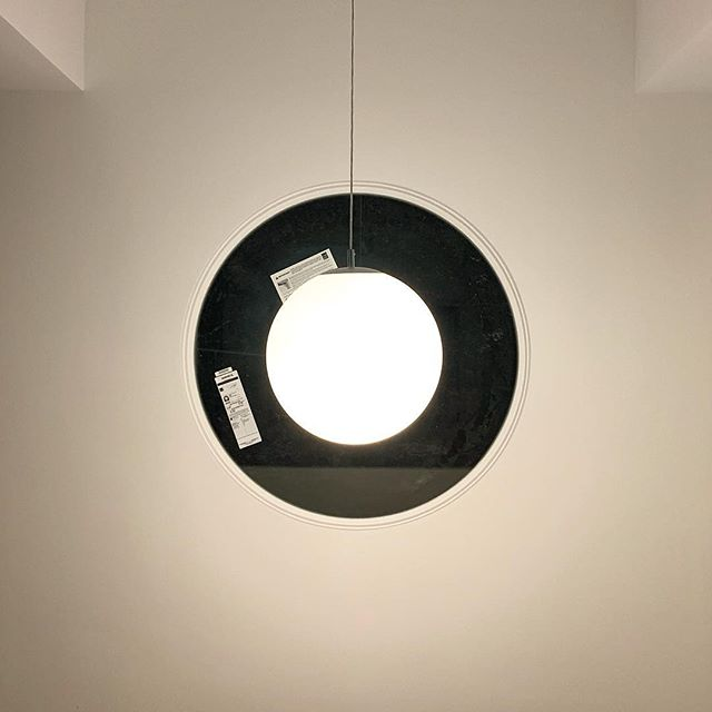 The new pendant is now hanging in the house, and I couldn't wait to take a picture of it lit at night against the round window behind it! 👁 . . . #lighting #homerenovation #almosthome #eyeball