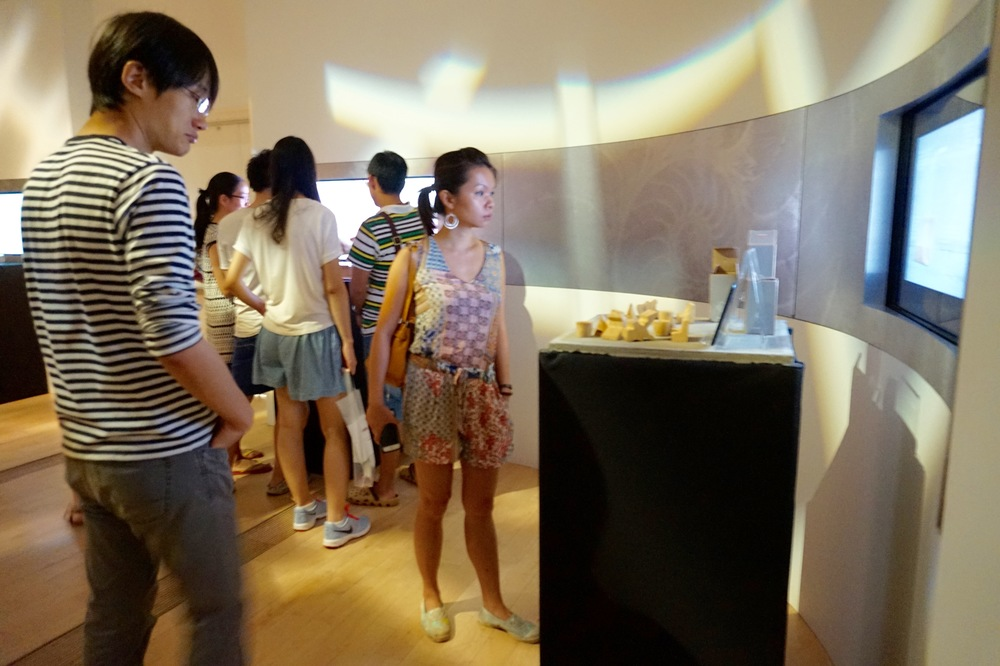 Visitors encounter future prototypes as part of the Signals of Tomorrow Innovation Lab for FutureEverything Singapore.