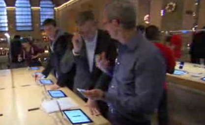 Grainy image capture of Tim Cook and Brian Williams