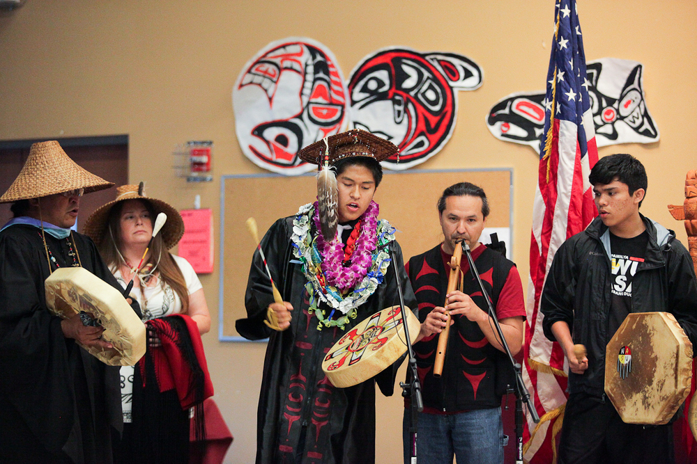 Senior Docavie Vendiola, center, leads a song during the graduation ceremonies for the Lummi Nation.