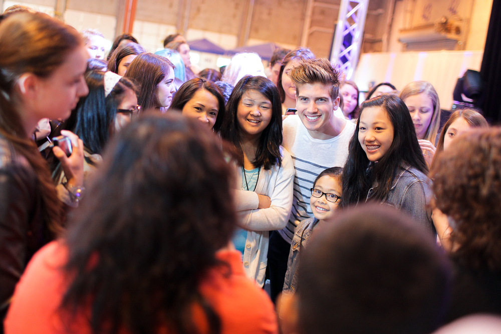 Joey Graceffa takes pictures with fans at the first ever Vlogger Fair in Seattle Saturday June 8 at the Port of Seattle Terminal 5.