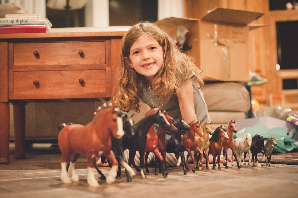 While packing up our house on Inman, I discovered my Breyer horse models that were tucked away and decided they would be a perfect birthday gift for Ella.  She loves them!