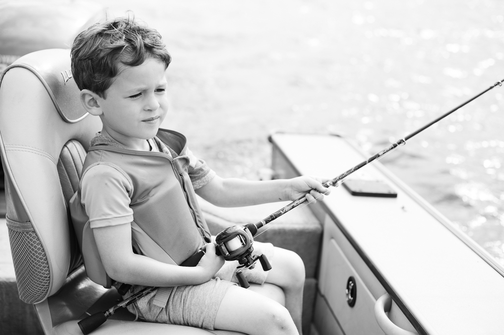 Michael's already telling tall tales once off the boat.  A true fisherman has been born.