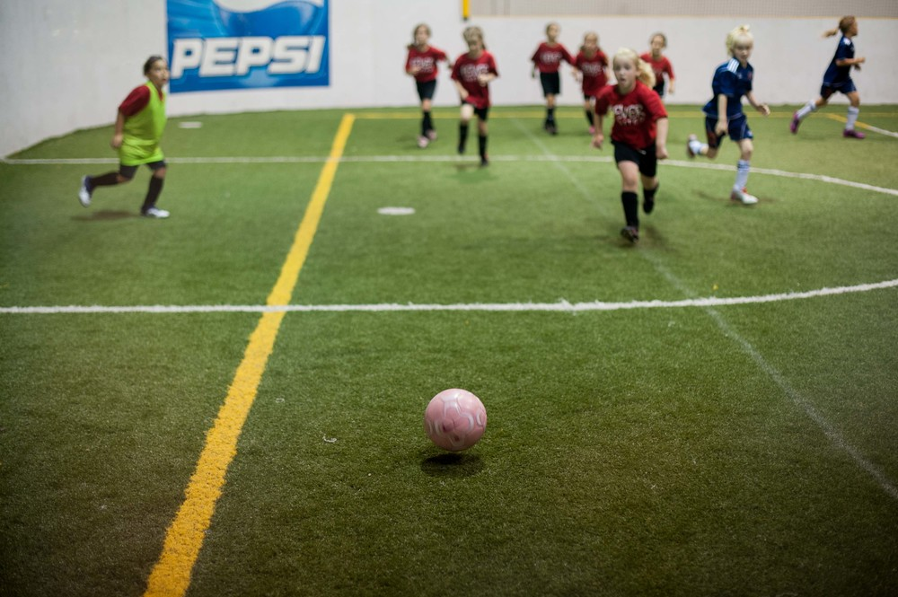 Ella is hanging tough with the new indoor soccer team she joined for the summer.  The girls are playing up against some really aggressive teams but we're so proud of her for sticking with it and making some new friends along the way.  They're in it together afterall!