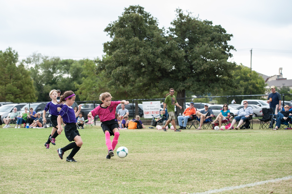 Ella's been lighting up the soccer field lately -- for two games in a row, she has scored the only two goals for her team.  The girls are playing so well together, cheering each other on and learning the game.