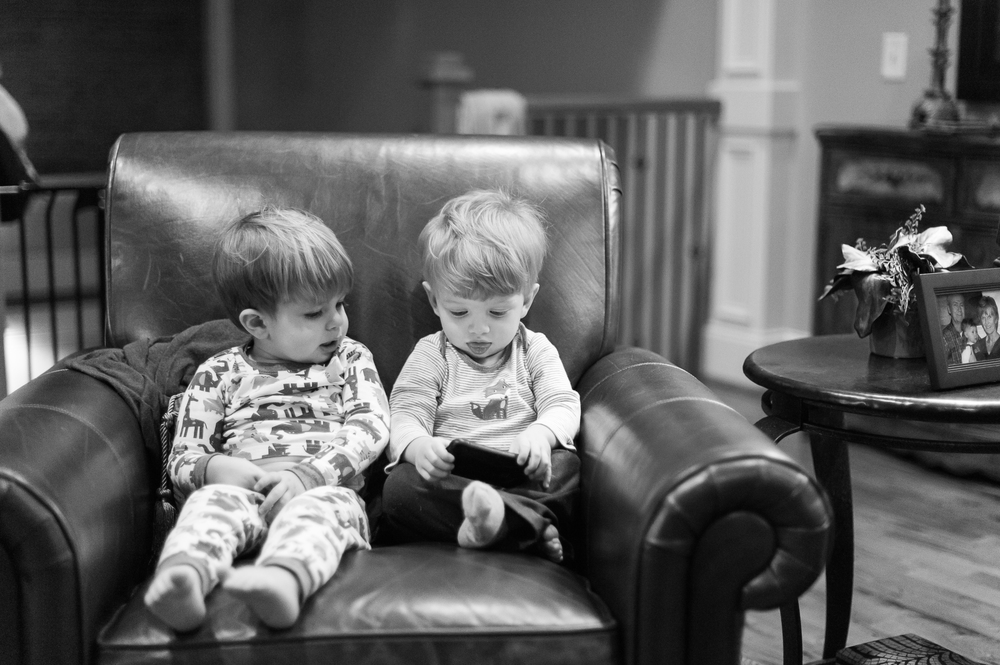 One day, these boys will both stand over six feet tall.  We'll need to get them a bigger chair to share.