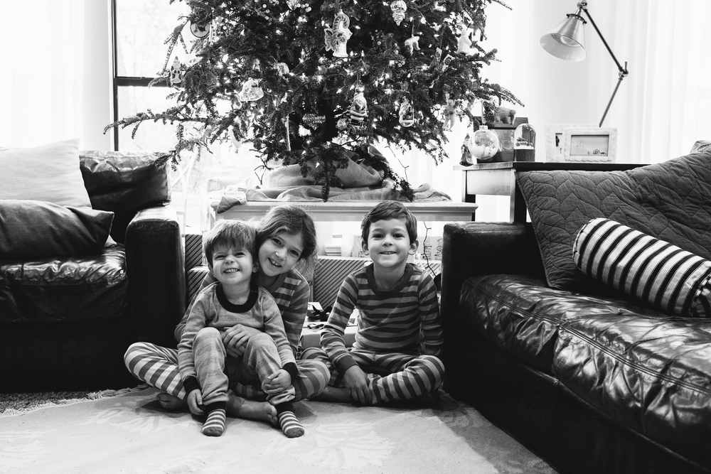 How to get your kids to pose for just one quick photo together on Christmas morning?  Threaten not to let them open any gifts until the next day.  Yes, I went there.