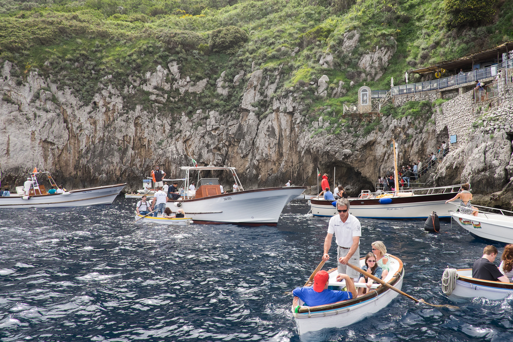 Queuing to go into the Blue Grotto -- getting in and out of the little dinghy was a fun little adventure.