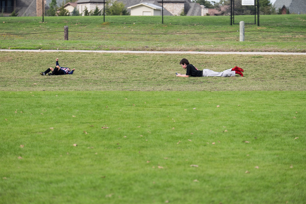 Both boys were rolling down the hill, of course, by the time I grabbed my camera, Drew had stopped to check his phone.
