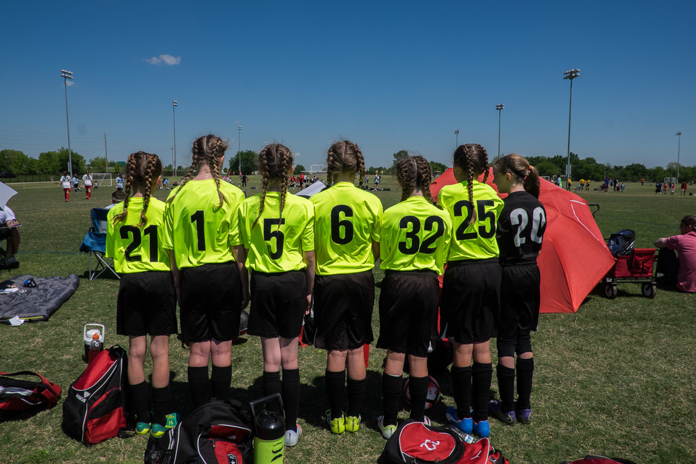 Following the end of the regular season, Ella's team competed in their first travel tournament.  Several of the team members wore double French braids the first day which was a great idea until it came time to cheer them on from across the field -- and we couldn't tell who was who!