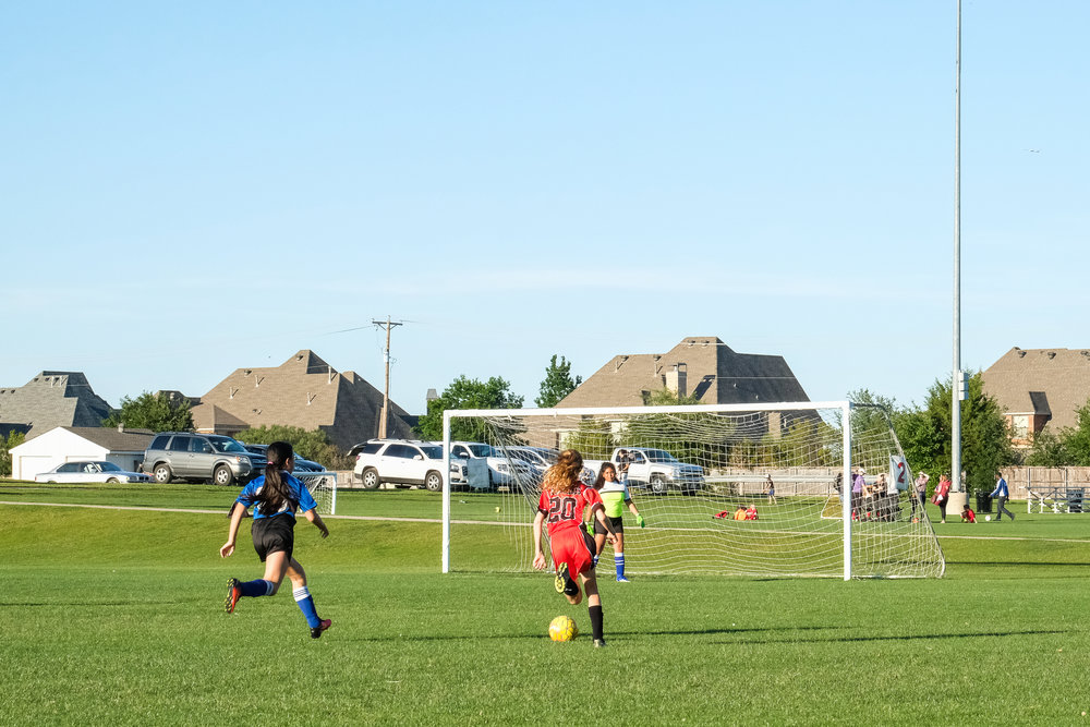 Here she is, advancing one (of three!) goals up the field.