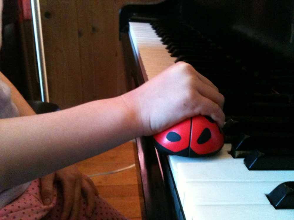 Ladybug under a 5-year-old student's hand.