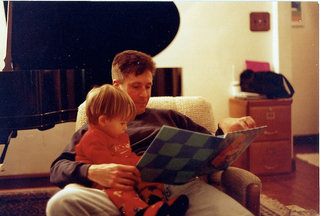 Keith Snell reading to my son, Bryce, age 2, in 1997.
