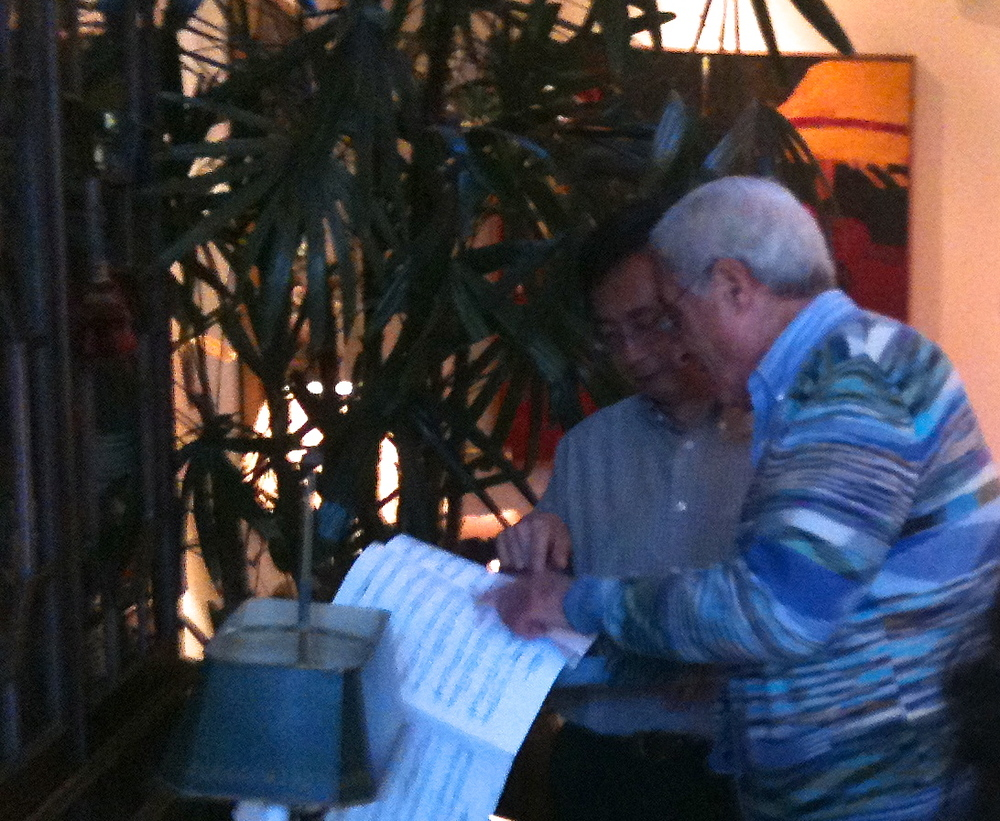 Dave and Chungte study a score after the performances.