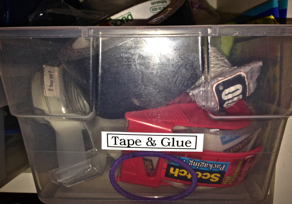 This label worked fairly well. The box does contain both tape AND glue. (I'm ignoring the hair elastic and bungee cord.)