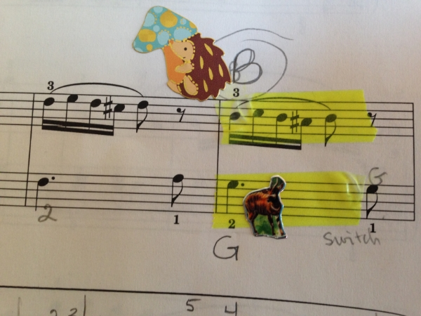 In the Lynes Sonatina from the  Sonatinas Book One , Tasha used this little hedgehog to remind her that when this theme returned it was different. The other animal reminded her left hand to stay put. The week after we did this she returned with the entire piece memorized including the correct notes in the recapitulation. She also used  Colored Highlighter Tape .