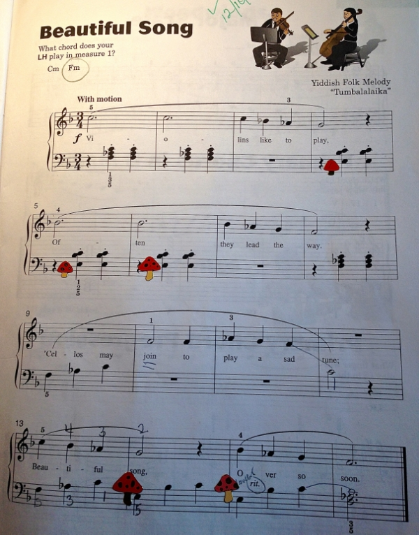 In this piece from  Piano Town Lessons Level Two , Mady was having a hard time remembering what the V7 chords felt like when the notes were broken up. She thought that putting little red mushrooms on each V7 chord might help her remember how it felt when she saw the notes one-at-a-time. She was right!