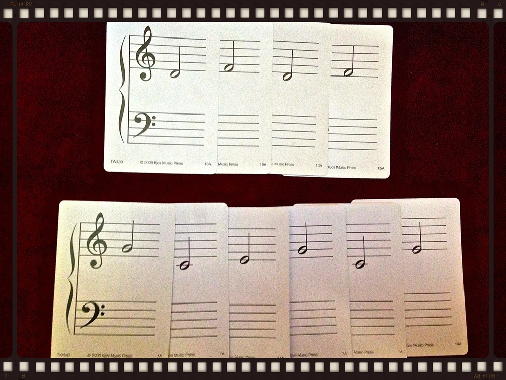 Note that I have placed the flashcards so that they overlap - hiding the multiple treble and bass clefs. This is a great way to make comparisons easier. If you're feeling really ambitious you could even extend the staff lines. I've never gotten that far.