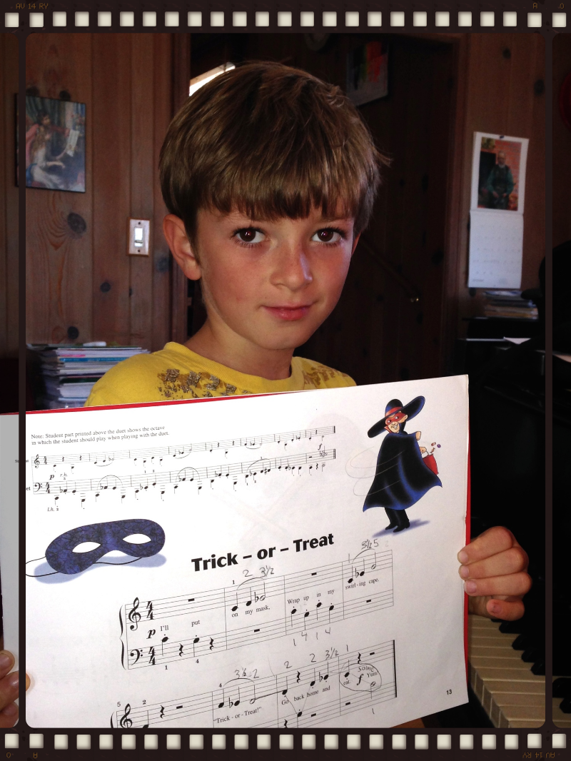 "Here's Benjamin with his Halloween piece - learned ""too early"" for the recital. He'll be moving on to something harder."