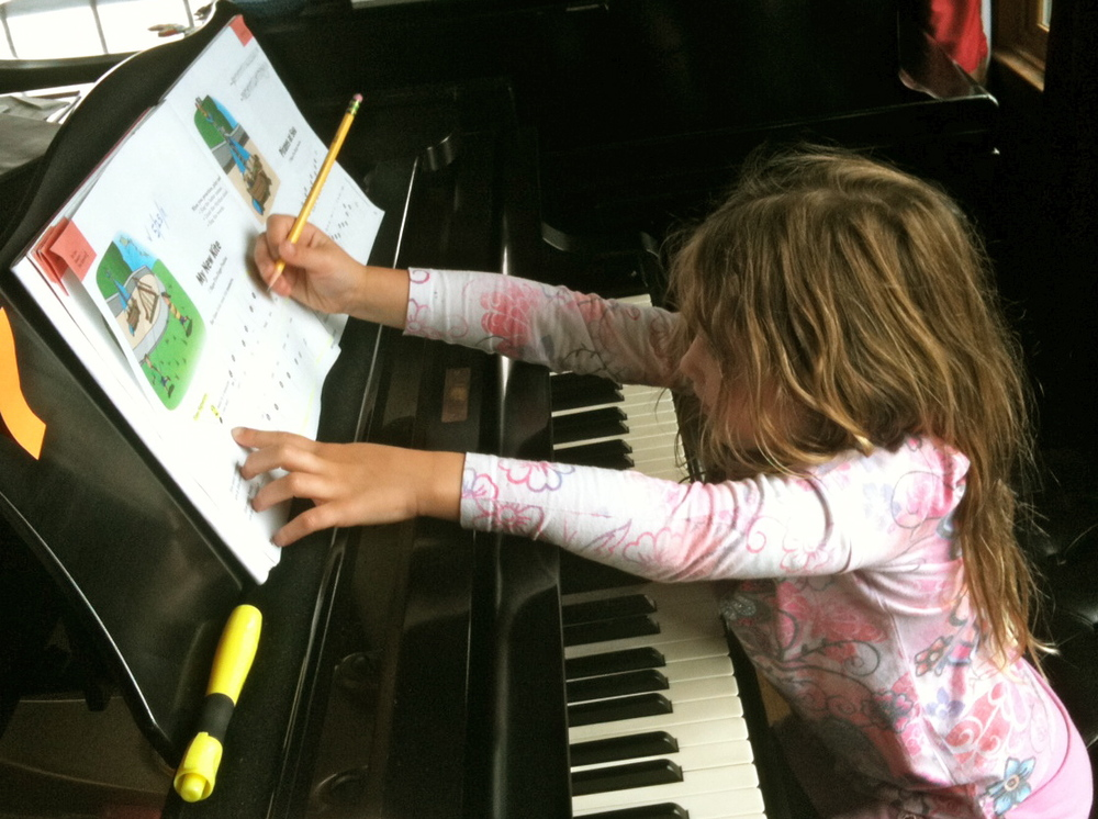 Sabine, three years ago, age 5, writing in her own fingering.