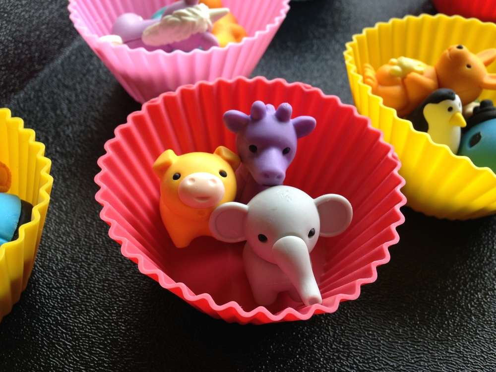 I like to give the students the erasers in these cute silicone cupcake holders. They're bright, lightweight and easy-to-store.