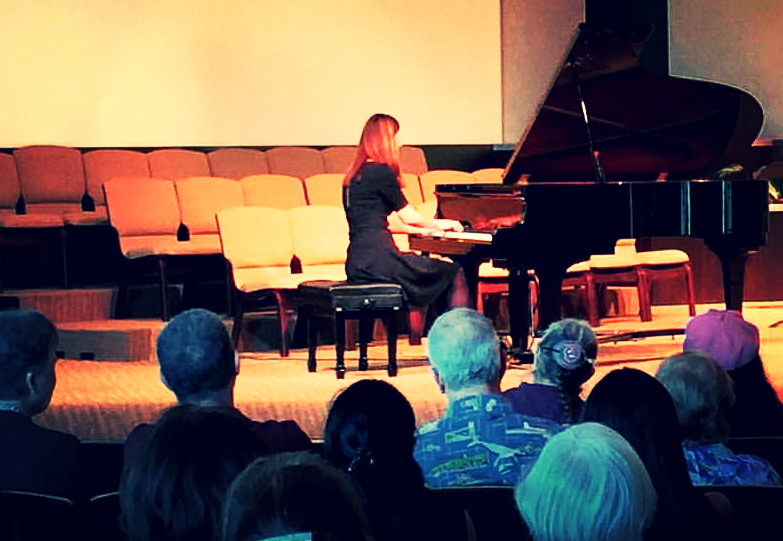 Janet playing a recital at her church.