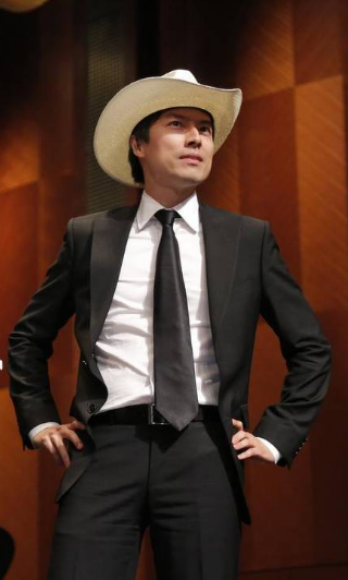Thomas Yu modeling the cowboy hat he received as winner of the Press Jury Award.