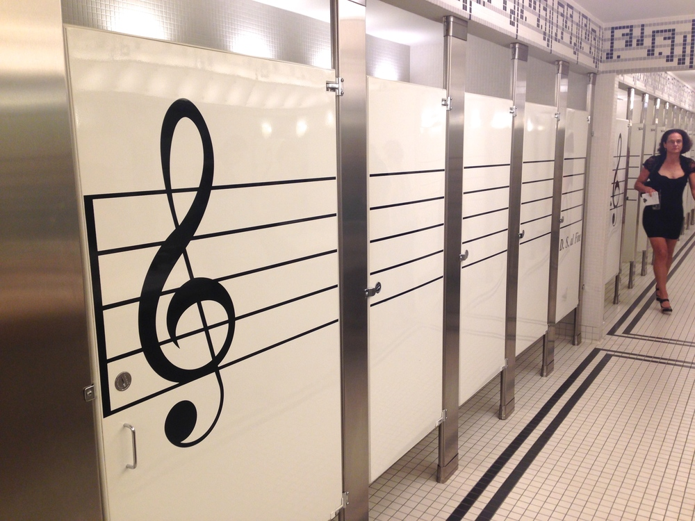The women's bathroom stalls at Bass Hall in Fort Worth are surprisingly free from musical graffiti.
