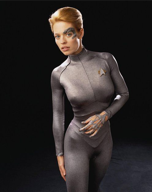 The frighteningly voluptuous Jeri Ryan as Seven of Nine in Star Trek: Voyager. Apparently her character also plays the piano.