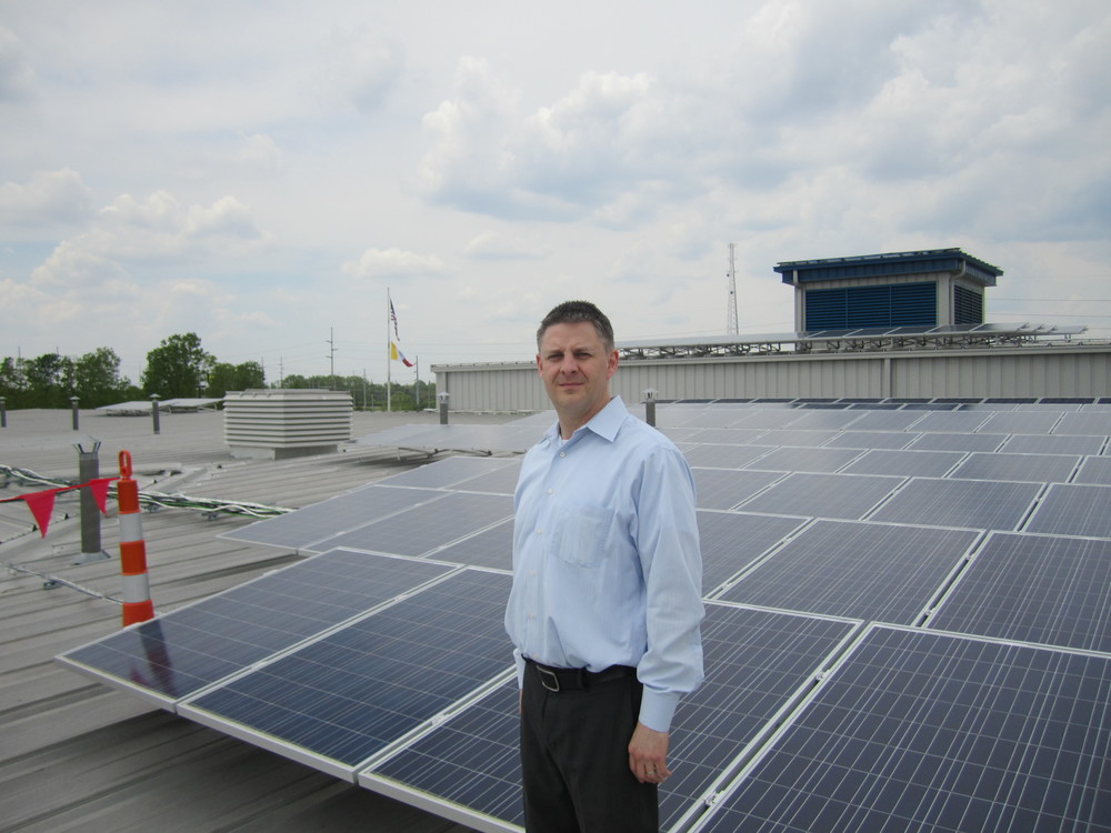 Tipping Point CEO Eric Zimmer in front of the 636 KW solar array developed by Tipping Point for the City of Columbus