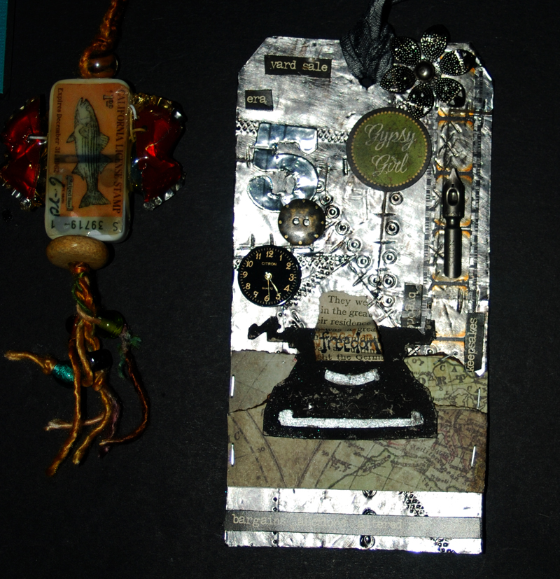 tim holtz september metal tag next to fishwife on my desk