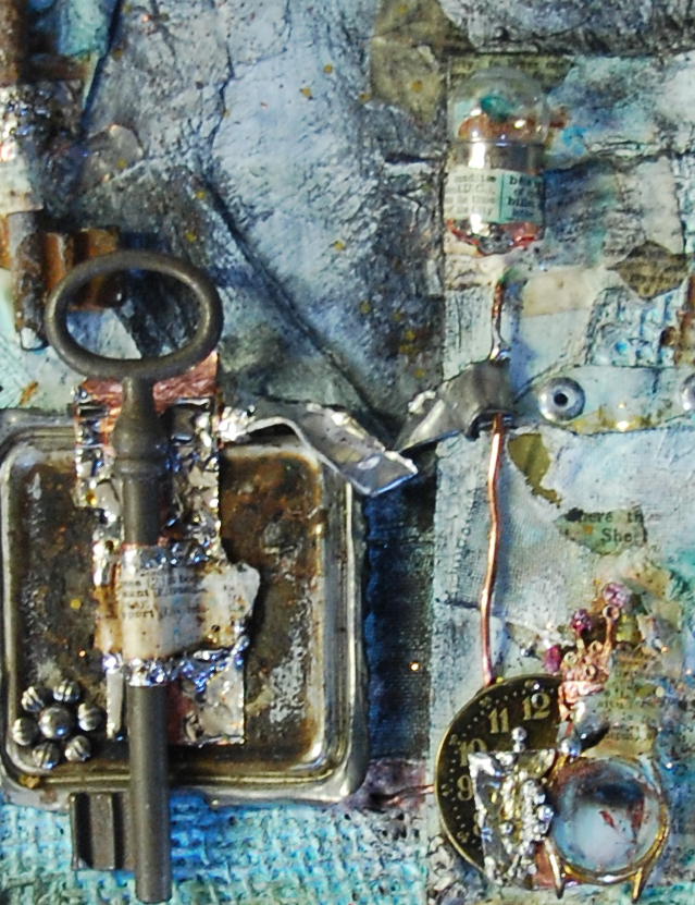 Nick Bantock ink pad tin cut up and soldered to a key....watch bit filled with a cropped minature my adonnathing logo face I painted eons ago)