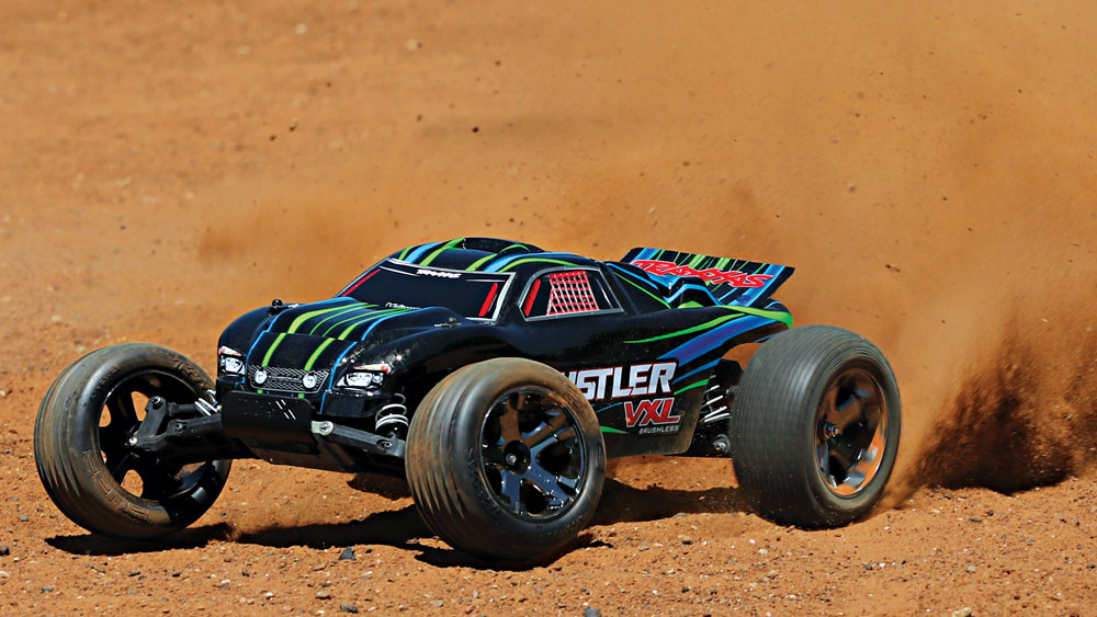 37076-4-Rustler-VXL-Action-GREEN-Dirt-RtoL.jpg