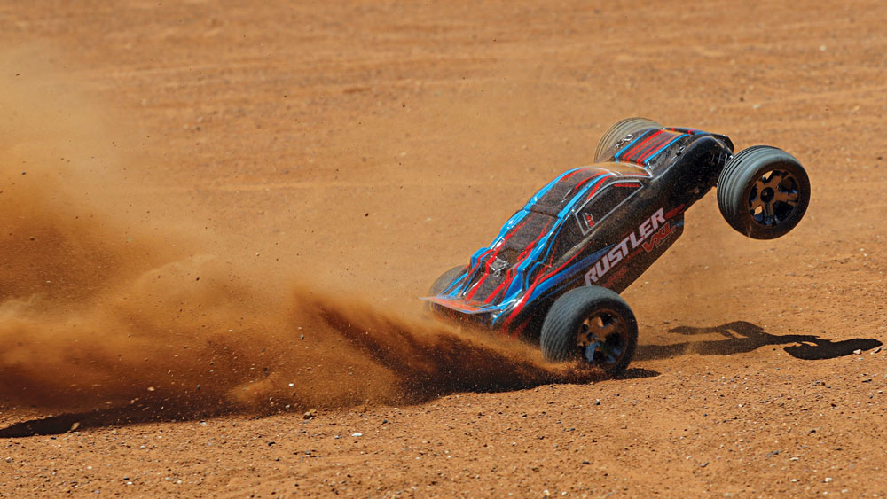 37076-4-Rustler-VXL-Action-RED-Dirt-Rear-Wheelie.jpg