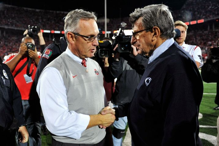 COLUMBUS, OH - NOVEMBER 13: Head Coach Jim Tressel of the Ohio State Buckeyes greets Head Coach Joe Paterno of the Penn State Nittany Lions at midfield following the Buckeyes' 38-14 win over the Nittany Lions at Ohio Stadium on November 13, 2010 in Columbus, Ohio. (Photo by Jamie Sabau/Getty Images)