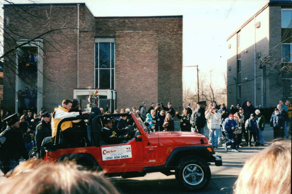 Brian Griese and Charles Woodson travel up State Street during the national championship celebratory parade in January of 1998.
